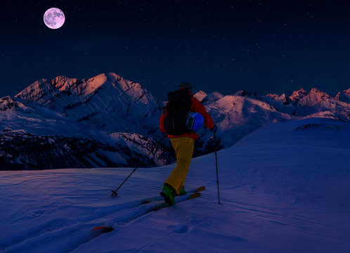 Scenic night backcountry ski panorama sunset landscape of Crans-Montana range in Swiss Alps mountains with peak in background, Verbier, Switzerland.