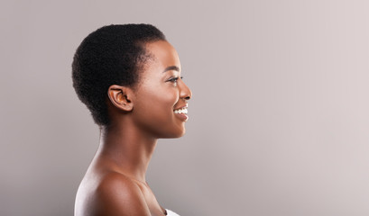 Fototapete - Profile portrait of woman with perfect skin and white teeth