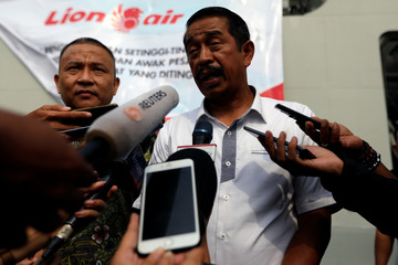 CEO of Lion Air Group Edward Sirait talks to journalists as he arrives at Jakarta International Port after attending one-year commemoration of the Lion Air JT-610 which crashed at Java sea, in Jakarta