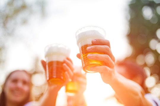 Friends enjoying drinking beer in the backyard.