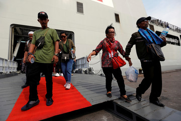 Relatives of passengers who died on Lion Air JT610 crash at the Java sea, arrive at Jakarta International port after attending one-year commemoration of the crash in Jakarta
