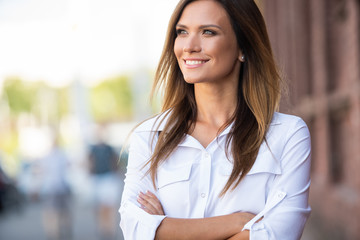 Portrait of a successful business woman smiling Wall mural
