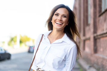 Portrait of a successful business woman smiling Fotomurales