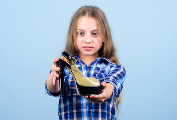 Shoes shop. Fashion store. Play with moms shoes. Every girl dreaming about fashionable high heels. Little fashionista with high heels. Boutique concept. Excited about high heels. Female attribute