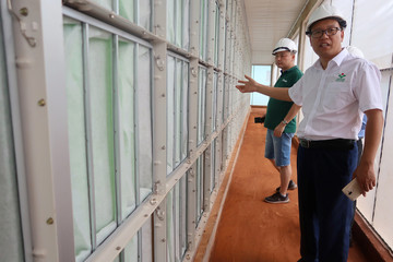 Zhang Xiangjun, manager of New Hope Liuhe's Binh Phuoc pig farm, shows journalists the farm's filtering systems as part of its biosecurity measures against African swine fever disease in Binh Phuoc