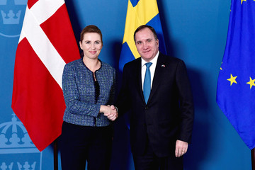 Denmark's Prime Minister Mette Frederiksen and Sweden's Prime Minister Stefan Lofven shake hands during a photo opportunity at Rosenbad in Stockholm