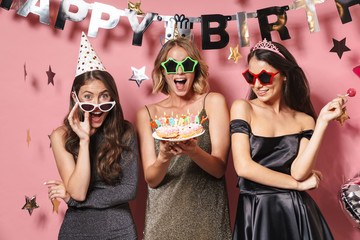 Image of beautiful party girls in glamour sunglasses holding birthday cake
