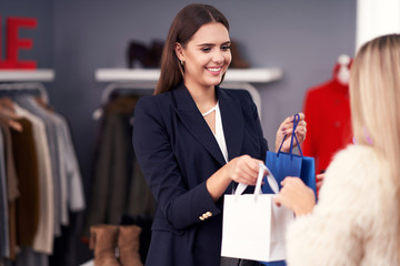 Shop assistant serving the customer in store