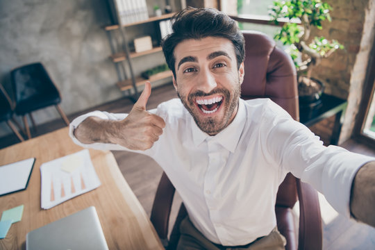 Great partnership online meeting. Close up photo of positive cheerful middle eastern entrepreneur make selfie show thumb up approve his new work clients sit chair in loft workstation