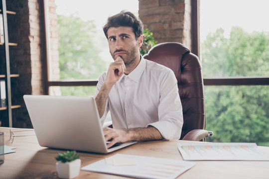 What answer.... Portrait of doubtful thoughtful middle eastern business man using his laptop communicate with enterprise partners investors want find solution decision to get aim sit table in loft