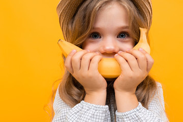 cute baby holding a banana instead of a smile, photo of a beautiful little girl