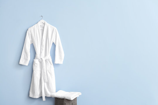 Clean bathrobe hanging on wall in room