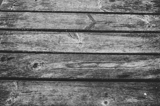 Old wooden brown background. Texture. Place for text. close up. part of the wooden bridge. black and white photo
