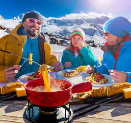 Fototapete - Ski restaurant lunch break with Fondue cheese, mountain view of Val Thorens, 3 valleys , France.
