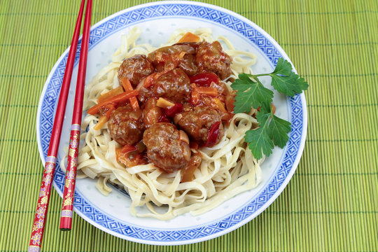 beef dumplings sweet and sour sauce and noodles