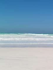 Wall Murals Beach sand beach crystal clear water blu sky