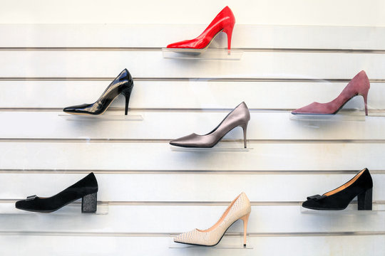 Womens shoes on shelves. Collection of shoe display in store window for sale