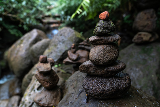 Cairns and markers at Manoa falls trail, Honolulu Hawaii