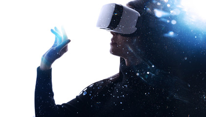 Wall Mural - Double exposure of female face. Abstract woman portrait. Digital art. Beautiful female in VR helmet scrolling invisible screen while interacting with virtual reality under neon light.