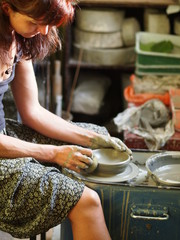 A girl molding pottery in her hands / handicarfts at home / Creating Pottery With Clay