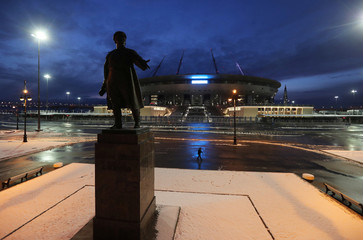 A view shows a monument to Sergei Kirov in front of the Gazprom Arena stadium in Saint Petersburg