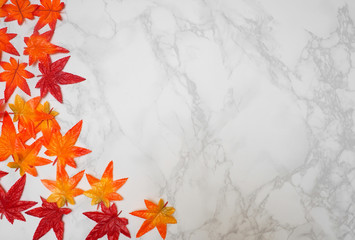 Wall Mural - Maple leaf on marble floor background.Top view