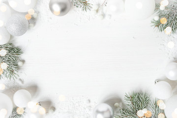 White Christmas background with spruce frosty brunches and Christmas lights