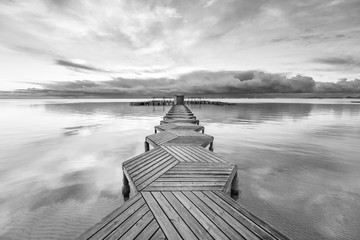 Dock with wood in zig zag in the morning at Mar Menor, Spain.
