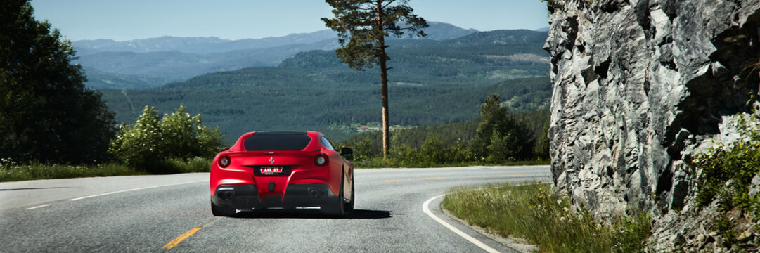 Miland, Norway. 04.06.2016. Red Ferrari F12 on the road.
