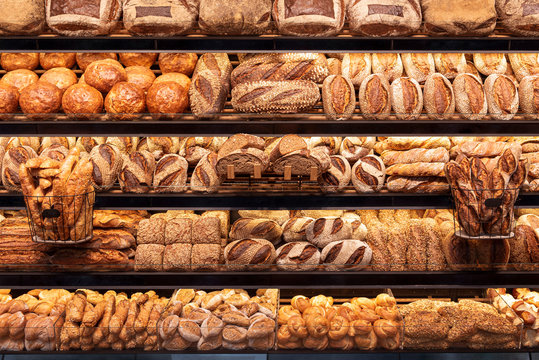 Bakery shelf with many types of bread. Tasty german bread loaves on the shelves
