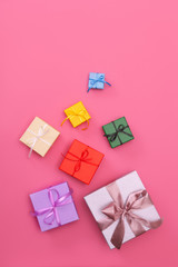Multi-colored gift boxes with bow. Flatlay.