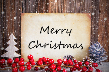 Paper With English Text Merry Christmas. Christmas Decoration And Wooden Background With Snow