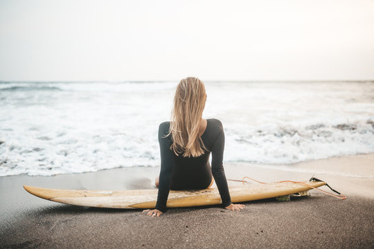 woman with surfing n the beach, Bali, Indonesia