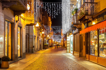 Street of Alba decorated and illuminated for winter holidays.