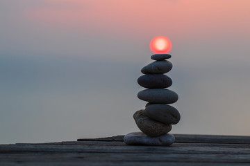 Photo sur Plexiglas Zen pierres a sable Zen concept. Sunset. The object of the stones on the beach at sunset. Relax & Meditation.