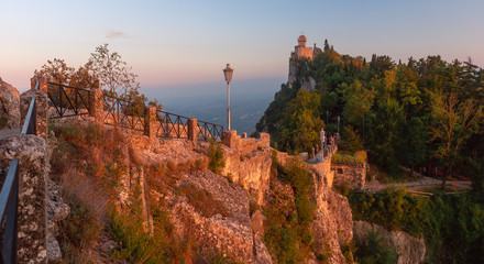 Fototapete - Panorama of De La Fratta or Cesta, Second Tower on Mount Titano, in city of San Marino of Republic of San Marino during gold hour at sunset