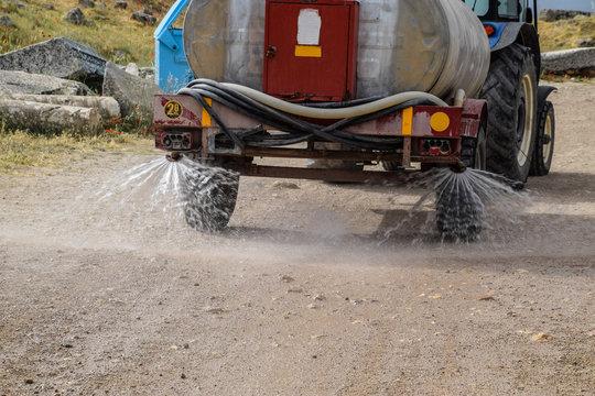 Machine for moistening dust on road.
