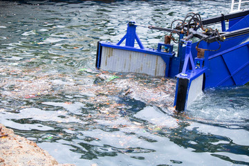The handles of the vehicle that clean the garbage in the sea. Picking up the trash. Prevention of environmental pollution at sea.