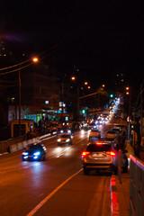 Night highway - cars drive along a narrow road. Headlights, cars, road, traffic. Subtropics, summer, heat, rest, vacation, relaxation evening night Russia Sochi - September 2019