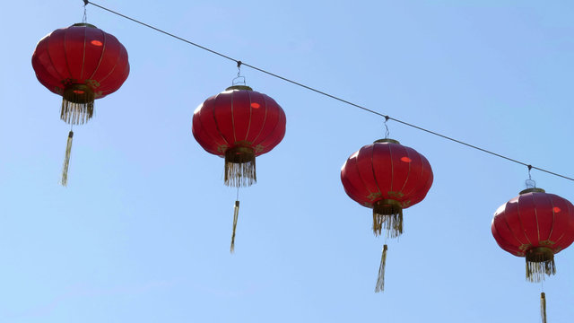 chinese lanterns above a street in chinatown of san francisco
