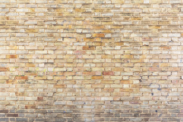 Abstract weathered stained background of brick wall texture, grungy rusty architecture wallpaper