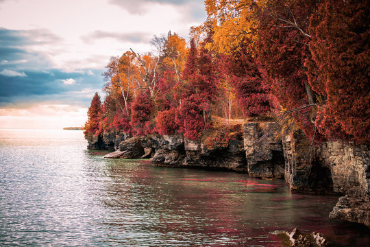 Red and orange trees on the coastal cliffs of Door County, Wisconsin USA.