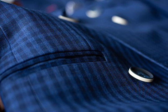 The blue suit cloth was laid on the floor and there was space for adding text. Blue fabric with buttons and pockets for tailoring.
