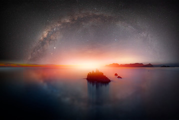 Wall Mural - The milky way galaxy over the sea and  silhouette of rock in the night sky