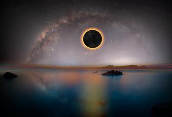 Fototapete - Solar Eclipse with milky way