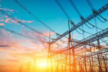 High voltage electricity tower at sunset.substation industrial background.