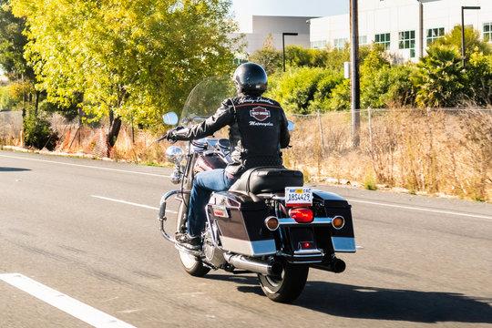 Oct 18, 2019 San Jose / California / USA - Biker riding a Harley Davidson motorcycle on the freeway; San Francisco bay area