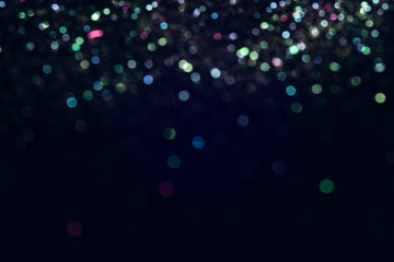 colorful bokeh like shining star on black background