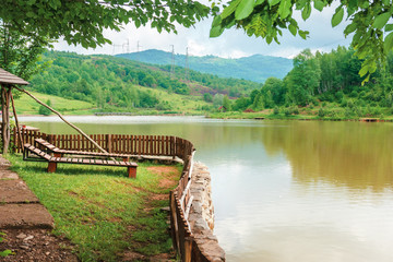 place for rest on the shore of mountain lake. beautiful nature scenery in spring time.place for...