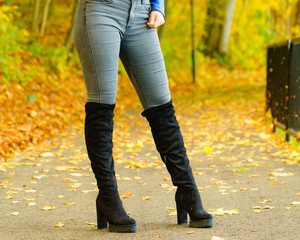 Woman wearing black knee high boots